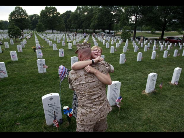 RNPS IMAGES OF THE YEAR 2010 - Monica McNeal (R) cries as she hugs a U.S. Marine at the grave (L) of her 19-year-old son Eric Ward, at Arlington National Cemetery, May 27, 2010. Lance Corporal Eric Ward, a fourth-generation U.S. Marine, was killed in Afghanistan on February 21, 2010. The United States is commemorating Memorial Day this weekend.  REUTERS/Jason Reed (UNITED STATES - Tags: MILITARY IMAGES OF THE DAY)