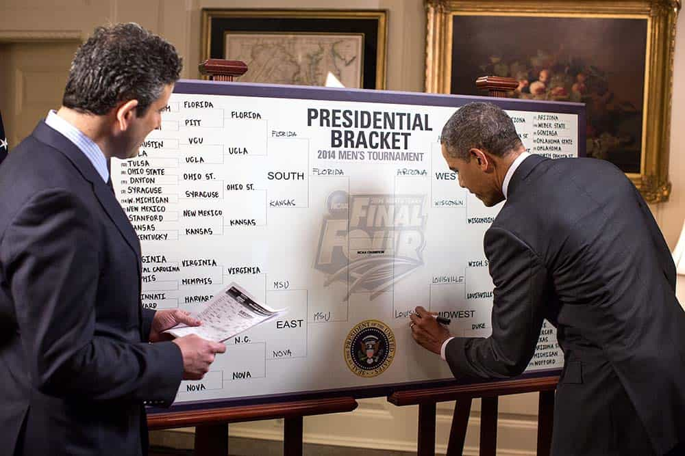 President Barack Obama participates in an ESPN interview with Andy Katz regarding the President's 2014 NCAA Division I Men's Basketball Tournament bracket, in the Map Room of the White House, March 18, 2014. (Official White House Photo by Pete Souza) This official White House photograph is being made available only for publication by news organizations and/or for personal use printing by the subject(s) of the photograph. The photograph may not be manipulated in any way and may not be used in commercial or political materials, advertisements, emails, products, promotions that in any way suggests approval or endorsement of the President, the First Family, or the White House.